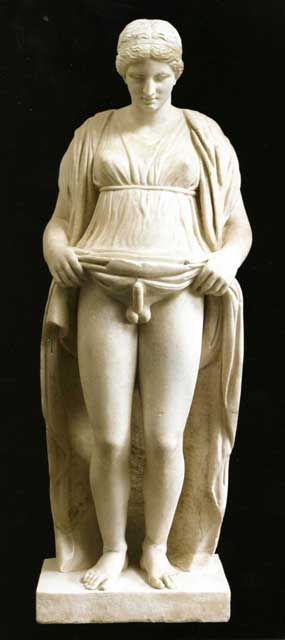 """Hermaphroditus, Roman marble, Imperial period (3rd century CE) -- This Hermaphroditus is called """"Stante"""" (relieved) because carved with the male member in erection, shown by the woman's dress lifted to the waist. Discovered in a vineyard of Monte Porzio Catone in 1781 and purchased by prince Marcantonio Borghese, it was long kept hidden in a closet because it was considered """"indecent"""""""
