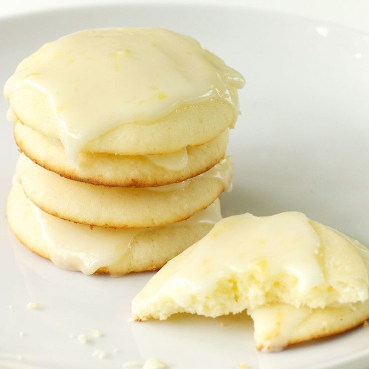 Lemon Ricotta Cookies w/Lemon Glaze - these ladylike little cookies puff up as they bake, and the lemon glaze on top adds a tart, crunchy layer.