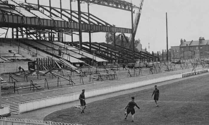 Players train while the new East stand is built. 1934