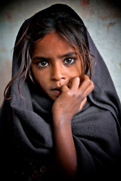 A young girl at the Haridwar train station, India