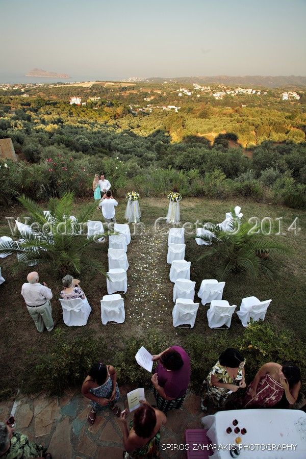 Weddings in Crete - Flower Stands, Petal Aisle and Chairs with White Covers.  Villa Chania area