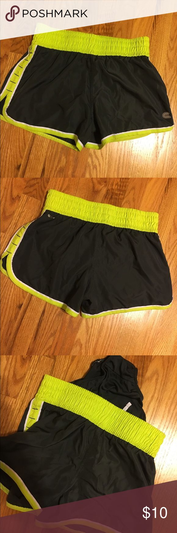Dark gray athletic shorts Size medium. Dark gray with green trim. Attached undergarment for running etc. Shorts