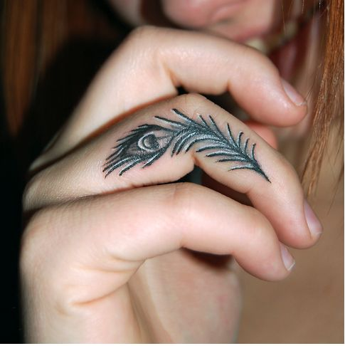 #tattoos fingertattoos peacock tattoo