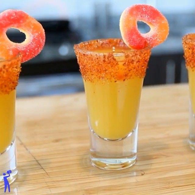 Peach Margarita Shots / 1oz Tequila, 1/2oz Triple Sec, 2oz Peach Puree, 1oz Peach Nectar, Fresh Lime Juice, Peach Rings (rim: chamay & tajin)