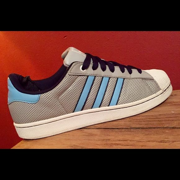 Adidas Shoes - Men's size 10! Men's Adidas Shoes - Size 10! Gray, baby blue & white! Inside of shoes  back heel have some wear & tear other than that these are in great condition!! See Pictures Adidas Shoes Athletic Shoes