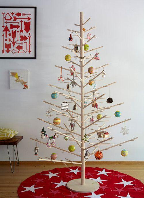original on etsy:  Minimal + modern wooden Christmas trees by ReTreeJoy. dowel tabletop for ornament display