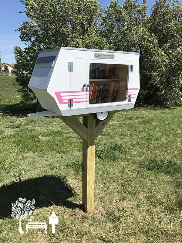 A vintage camper #LittleFreeLibrary #bookbox in a campground in Rapid City, South Dakota! How perfect!
