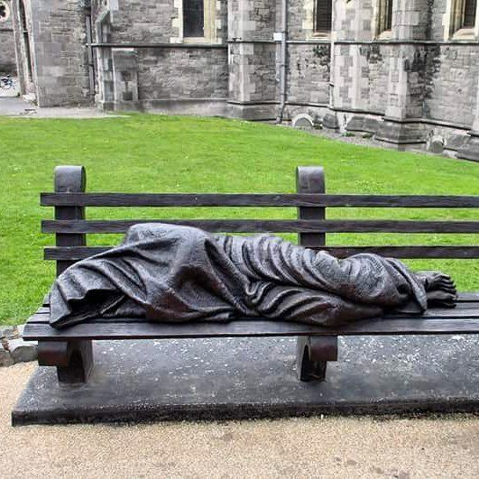 Statue in Dublin 3 of 3  #statue #christ #cristo #gesu #croce #cross #stigmati #barbone #homeless #clochard #banch #panchina #cold #freezing #sleep #sleeping #church #chiesa #iglesia #cathedral #statua #dublino #dublin #ireland #art by mydays_inslowmotion