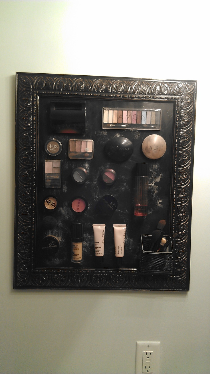 My first Pinterest project... Magnetic makeup frame. Gold frame from goodwill, $7.00. Black spray paint, $3.00. Slab of metal, $12.00, with plenty left over, and magnetic strips for $5.00. I simply sanded down the frame so the gold would shine through as we'll as the metal slab, love how it dresses up my bathroom and keeps my counters clutter free!