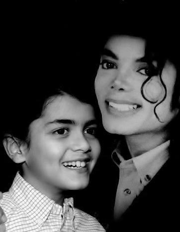 Michael and Blanket. No matter your opinion of MJ as a person no on can doubt his fatherly love for his children. Blanket is precious.