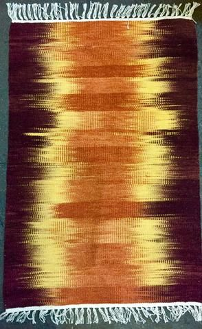 Handwoven wool rugs in Ikat design 50% off !
