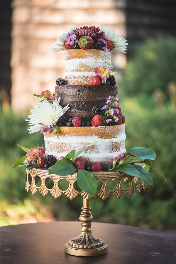 Naked wedding cake with chocolate tier and berries