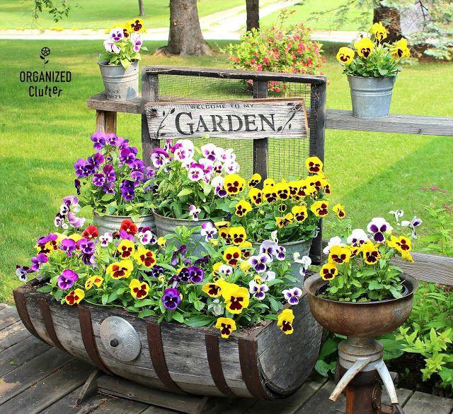 A Junk Garden Feature In Country Sampler Farmhouse Style