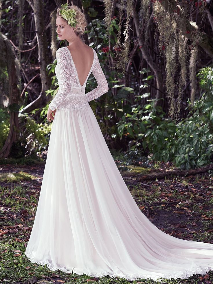 Understated elegance is found in this subtle lace and Santorini chiffon A-line wedding dress, complete with bateau neckline and long sleeves. Illusion lace details and stunning V-back create a sweet-yet-sexy style. Finished with zipper closure.
