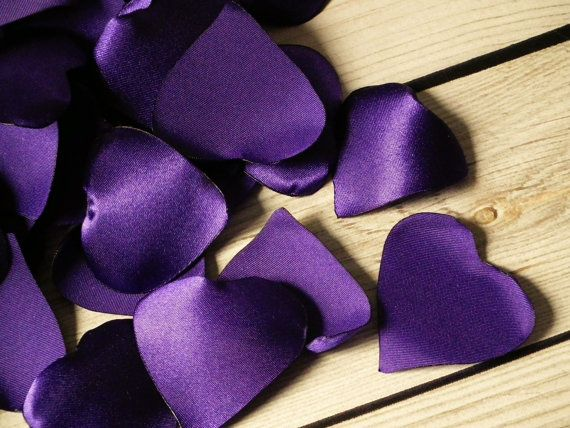 These heart-shaped alternatives to real rose petals are hand cut from purple satin, and the edges are heat-treated to resist fraying. This is just a remnant - only 12 petals here! Each is about 1 1/2 - 2 in diameter. More purple wedding decor can be found here: https://www.etsy.com/shop/ForeverSweethearts?ref=hdr_shop_menu&search_query=purple&pages=2