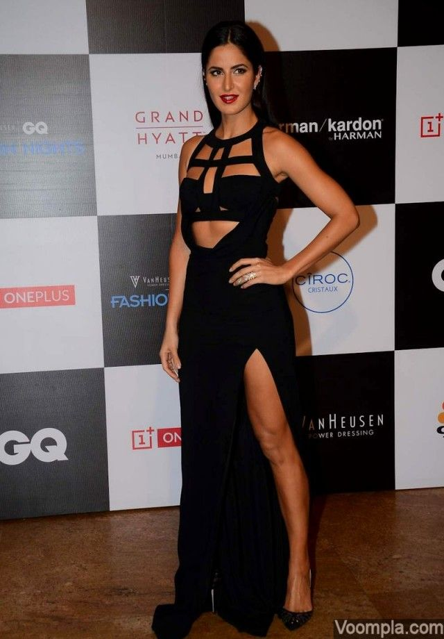 Katrina Kaif sizzles in a bold Philipp Plein dress featuring a strappy black bralette and a sky high slit on the gown that showed off the actress' toned thighs. via Voompla.com