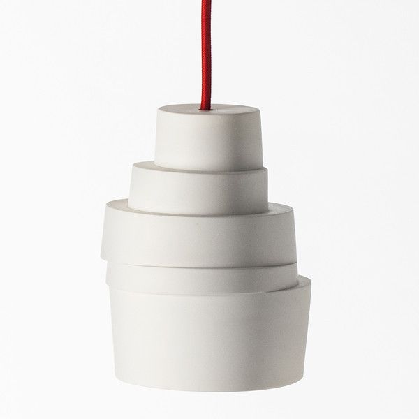 The Stacked Lamp consists of cylinder rings, which are stacked and staggered horizontally relative to each other. The cylinder's pure form is challenged by the precarious stacking and gives the products life between order and chaos. The delicate porcelain cylinder and the quirky and playful in the stacking creates some sculptural products.