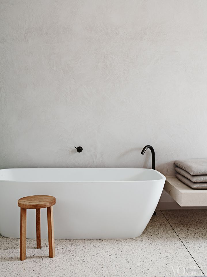 A serene bathroom in a Melbourne home designed by Michael Leeton. Photograph by Lisa Cohen.