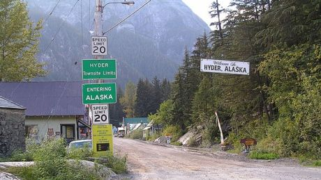 The tiny border crossing between Hyder, Alaska, and Stewart, B.C., will remain open overnight once again, but anyone crossing into Canada will have report in by telephone first.