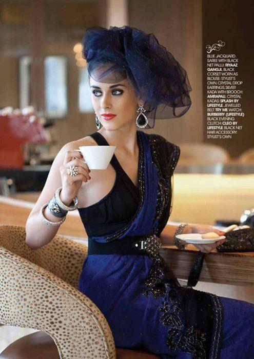 Riyaaz Gangji Blue Jacquard Saree with black net pallu with black corset worn as blouse