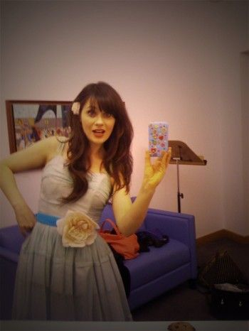 Zooey Deschanel writes music, sings, and acts on screens, small and big AND is a co-founder of hellogiggles