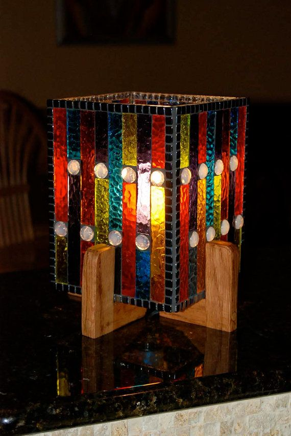 Original design that allow the colors to speak for themselves. Jewel-tone stained glass mosaic lamp with opal-like glass gems. Measures 9 1/2 tall by 6 1/2 square. Comes with a 40 watt energy saving bulb. Colorful OOAK addition to your home, day and night. Base constructed of solid oak. Thank you for visiting NatureUnderGlass.