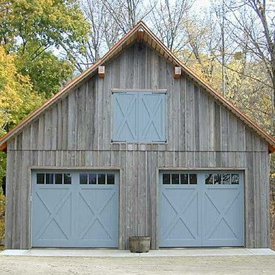 Weathered garage with blue trim and doors