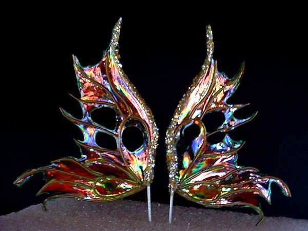 Stunning iridescent fairy wings are easier than you think to make.  These are for little dolls, but the process for kid sized ones is similar!