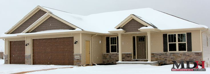 Ranch Style Home With Tan Siding Vinyl Shake In Gables