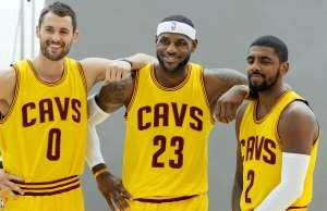Clevleand Cavaliers' Kevin Love, left, LeBron James and Kyrie Irving (2) get ready for a photo shoot with Sports Illustrated during the NBA basketball team's media day Friday, Sept. 26, 2014, in Independence, Ohio.