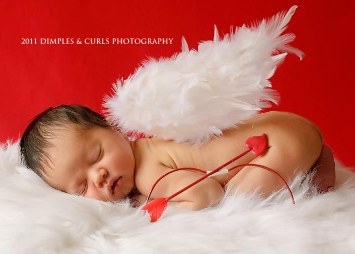 Cupid with arrow and angel wings