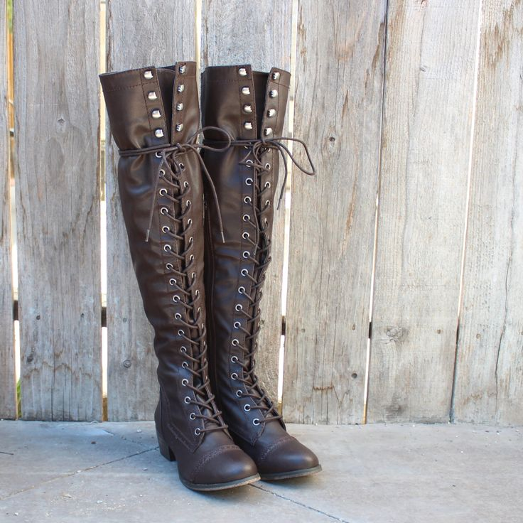 Amazing rich dark chocolate tone adorns these vintage inspired over the knee laced up boots. Features a laced up front, rugged soles, and a side zipper for easy
