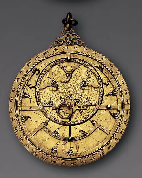 Silver-inlaid brass planispheric astrolabe Spain, probably Toledo, 14th century. Engraved copper alloy inlaid with silver. Source: Aga Khan Museum