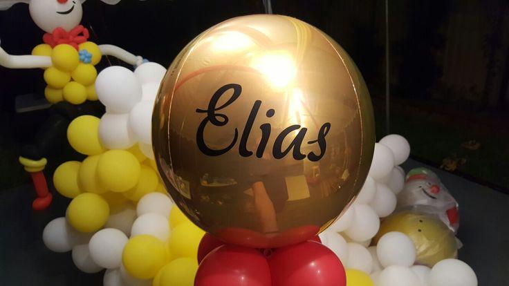 Black vinyl printing onto a gold orbz balloon. www.balloons.com.au