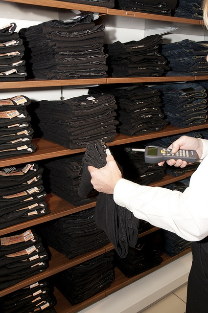 Price or stock check for a pair of jeans with the Nordic ID RF601 handheld in an apparel retail store.