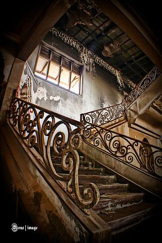 Magnificent staircase in derelict building.