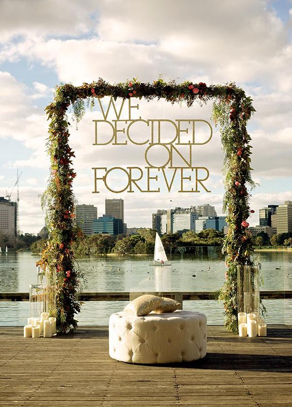 Custom Signage: Do you have a favorite wedding motto or logo? Hire a local woodworker to turn your design into a custom wood sign. Paint it in your colors (this one is a glittery gold), then suspend it from an archway made of greenery and flowers to create a picture-perfect focal point for your ceremony.