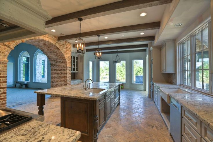 Love the brick arch and exposed beams