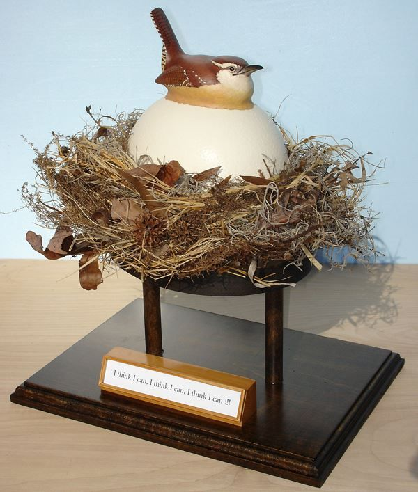 This birdhouse of my design won the Flight of Fancy category in the Raleigh, NC News & Observer birdhouse contest in 2007. I hand-carved the Carolina Wren from Tupelo wood and painted it. It is sitting on top of an actual Ostrich egg which has an entrance on the back for a Carolina Wren. I also made the stand, and the nest from gathered leaves and weeds. #birds #wren #nest #silly #inspiration #craft #ostrich