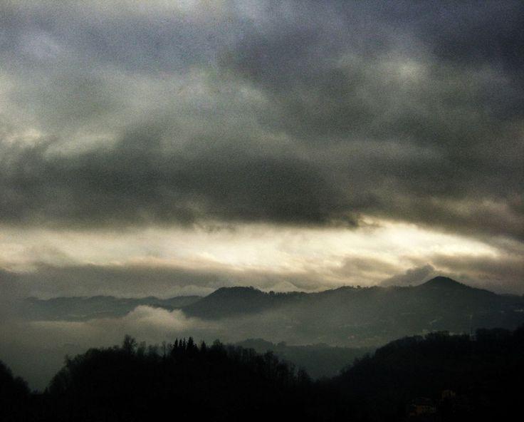 sky, mountain, scenics, tranquil scene, tranquility, cloud - sky, beauty in nature, cloudy, weather, silhouette, nature, mountain range, tree, overcast, landscape, cloud, idyllic, dusk, cloudscape, non-urban scene