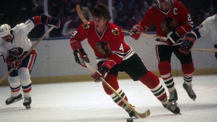 Bobby Orr salvages one last dominant rush as a member of the Chicago Black Hawks. Shades of a once great defender re-emerge in this photo.