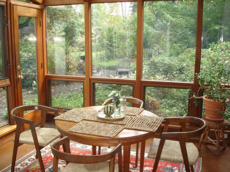 #sunroom #веранда #サンルーム Decorating A Sunroom Ideas With Diy Sunroom Plans A Beautiful Garden Landscape From A Small Sunroom Design With Dark Brown Frame And Glass And Round Tea Table With Unique Chairs On Wooden Laminate Flooring Design
