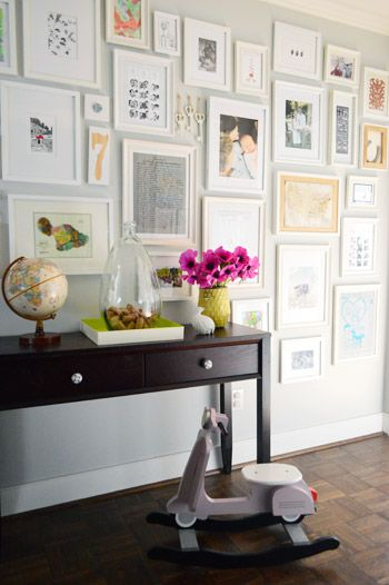 Fresh flowers make a hallway full of picture frames a little sweeter.