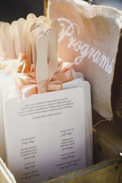 Such a cute idea! Keep your guests happy and cool with the hot weather. Turn your wedding programs into fans for the guests