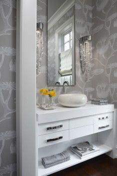 Luxurious Powder Room In Bathroom Equipped With Unique Washbasin Near Beautiful Orange Flowers
