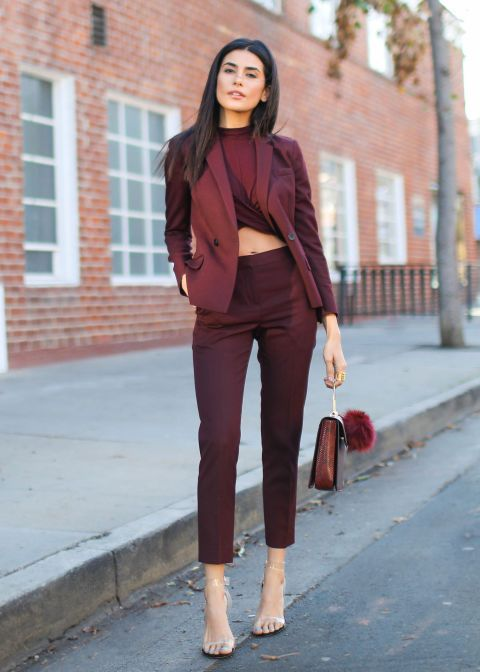 "Rich oxblood is a sophisticated alternative to holly berry-red, while festive cocktails with friends allows for traditional suiting to be shaken up. ""The crop top spices up the pantsuit and creates separation between the pieces,"" blogger Sazan Hendrix explained, a styling trick she uses to help define her short frame.  Topshop crop top, $26, topshop.com; Sandro blazer, $570, sandro-paris.com; Zara purse, $50, zara.com; Steve Madden sandals, $130, stevemadden.com; The Row cropped pants, $690…"