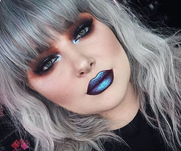 Bold alternative makeup  smokey eye and blue metallic  lips