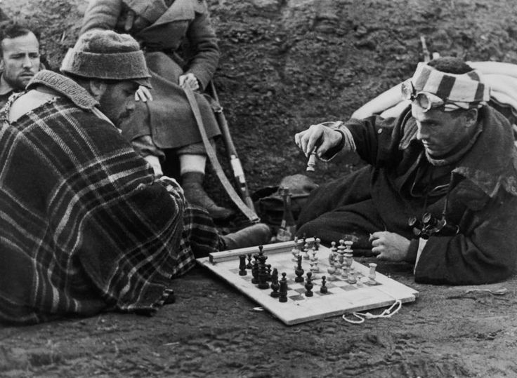 Henry plays chess with fellow International Brigades