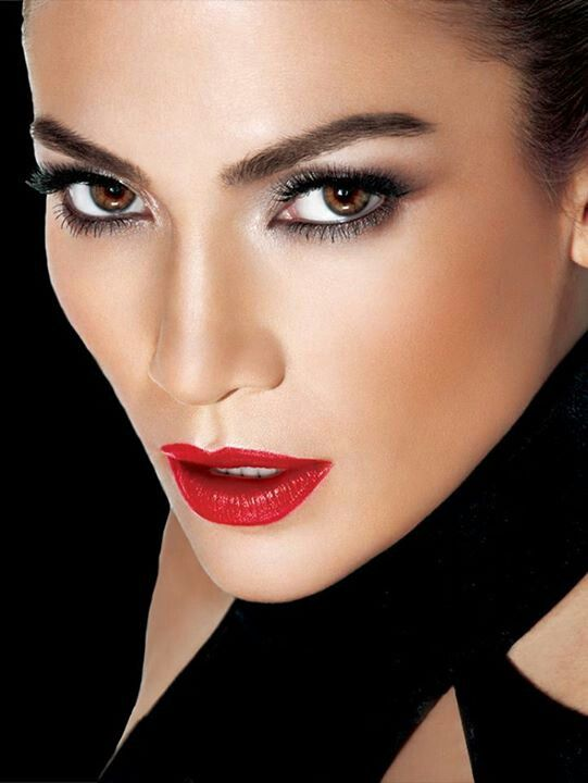 Jennifer Lopez-  With black again-  Love the smokey eye with the red lip and lots of lashes