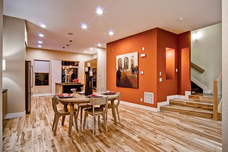 burnt orange wall paint Dining Room Contemporary with accent lighting beige wall